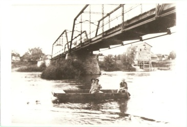 Delta Mills Bridge. View from the South Bank of the Grand River with the old Grist Mill in the background. Photo taken in 1899.