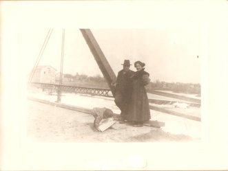 Picture taken in the 1890's of what is believed to be the Henderson family standing on the south end of the Delta Mills Bridge. Seen in the background is the Grist Mill.
