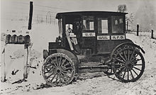 Rural carrier in an early electric vehicle, circa 1910